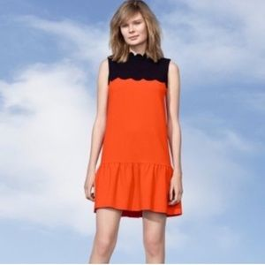 Orange and black scallop dress